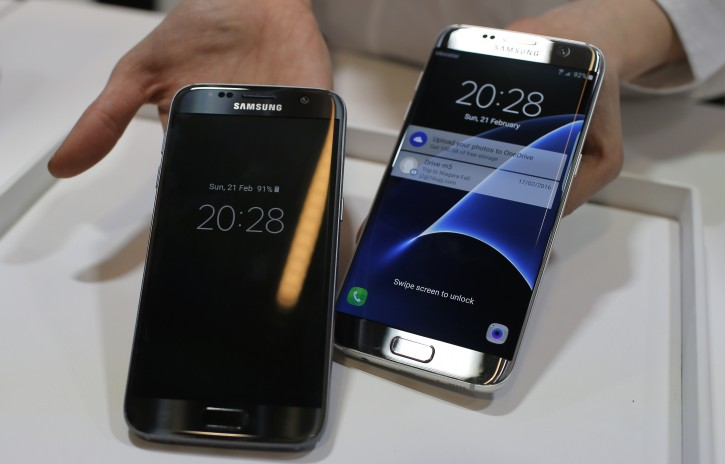 FILE - In this Sunday, Feb. 21, 2016, file photo, a Samsung Galaxy S7, left, and S7 Edge are displayed during the Samsung Galaxy Unpacked 2016 event on the eve of the Mobile World Congress wireless show, in Barcelona, Spain. (AP Photo/Manu Fernandez, File)
