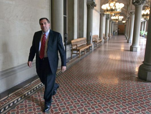 FILE - In this June 10, 2009 file photo, Steven Pigeon walks in a hallway at the Capitol in Albany, N.Y. The Democratic political operative from Buffalo has been charged as part of a corruption probe that has led to the resignation of a judge. Pigeon was charged Thursday morning, June 30, 2016, with bribery, rewarding official misconduct and grand larceny. He pleaded not guilty to the charges. Pigeon was expected to post the bail of $10,000 cash or $20,000 bond. (AP Photo/Mike Groll, File)