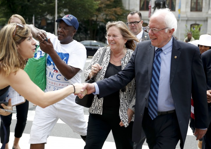 Sen. Bernie Sanders, I-Vt., right, shakes hands with a supporter in downtown Philadelphia, Thursday, July 28, 2016, during the final day of the Democratic National Convention. (AP Photo/John Minchillo)