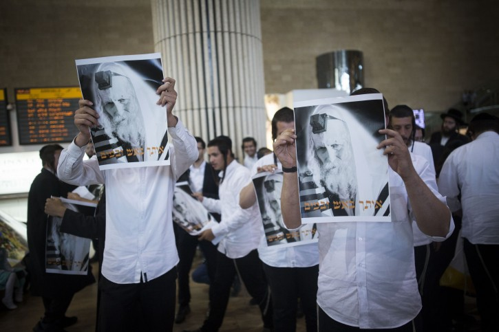 Ultra orthoodx jewish men gather to pray during a demonstration in support of Rabbi Eliezer Berland before his arrival to the Ben Gurion Airport in Tel Aviv, on July 19, 2016. Rabbi Berland left Israel to South Africa while he was suspected and under investigation for sexual assualt on women in his community. He was jailed in South Africa and is expected to be immediately arrested upon his arrival in Tel Aviv. Photo by Yonatan Sindel/Flash90 *