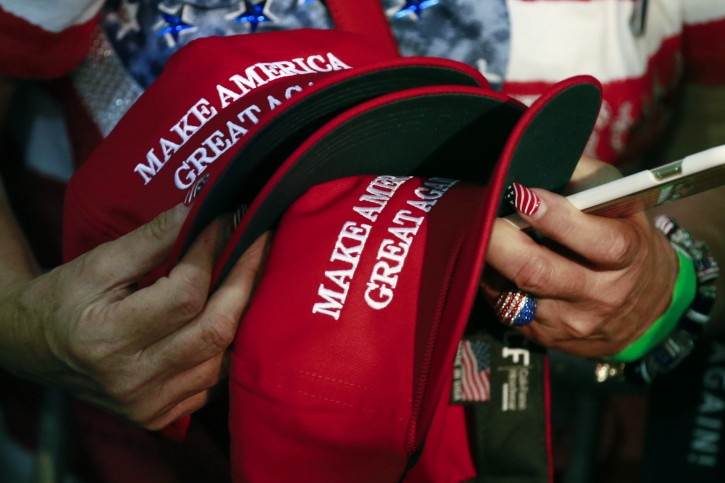 A woman holds hats to get them autographed by Republican presidential candidate Donald Trump during a rally, Thursday, June 2, 2016, in San Jose, Calif. (AP Photo/Jae C. Hong)
