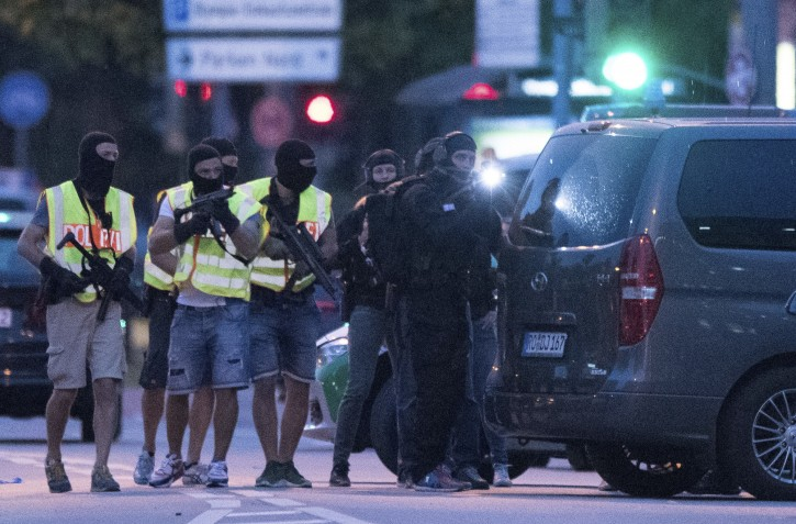 Special police forces prepare to search a neighboring shopping center outside the Olympia mall in Munich, southern Germany, Friday, July 22, 2016 after several people were killed in a shooting. (AP Photo/Sebastian Widmann)
