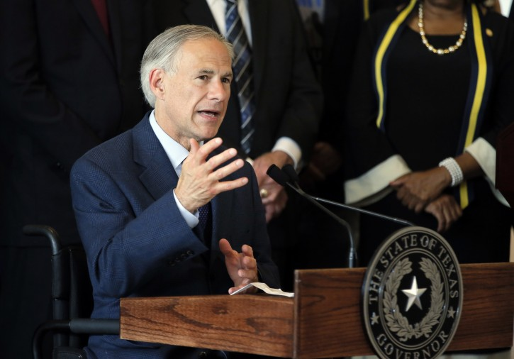 FILE - In this Friday, July 8, 2016 file photo, Texas Gov. Greg Abbott, right, responds to questions about the police shootings during a news conference at City Hall in Dallas.  AP