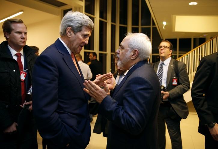 FILE - In this Jan. 16, 2016 file-pool photo, Secretary of State John Kerry talks with Iranian Foreign Minister Mohammad Javad Zarif in Vienna, after the International Atomic Energy Agency (IAEA) verified that Iran has met all conditions under the nuclear deal.  (Kevin Lamarque/Pool via AP, File)