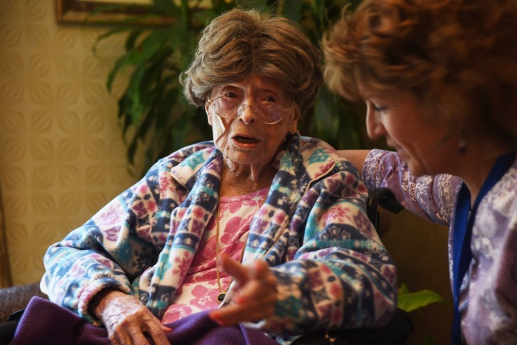 In this July 19, 2016, photo, Adele Dunlap, 113, talks with Susan Dempster, the Activities Director at Country Arch Care Center in Pittstown, N.J. (Chris Pedota/The Record of Bergen County via AP)