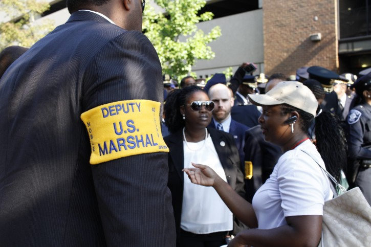 Over 1200 participants representing the National Organization of Black Law Enforcement (NOBLE), including police officers, civil rights leaders and supporters honored fallen police officers with a Memorial March at Howard University, Wednesday, July 20, 2016, in Washington. (AP Photo/Paul Holston)