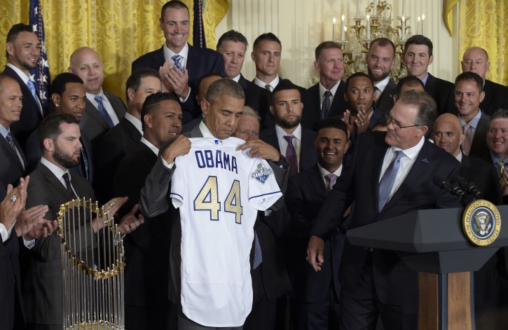 President Barack Obama holds up a personalized Kansas City Royals baseball jersey presented to him by team manager Ned Yost, right, during a ceremony in the East Room of the White House in Washington, Thursday, July 21, 2016, where the president honored the 2015 World Series Champion baseball team. (AP Photo/Susan Walsh)