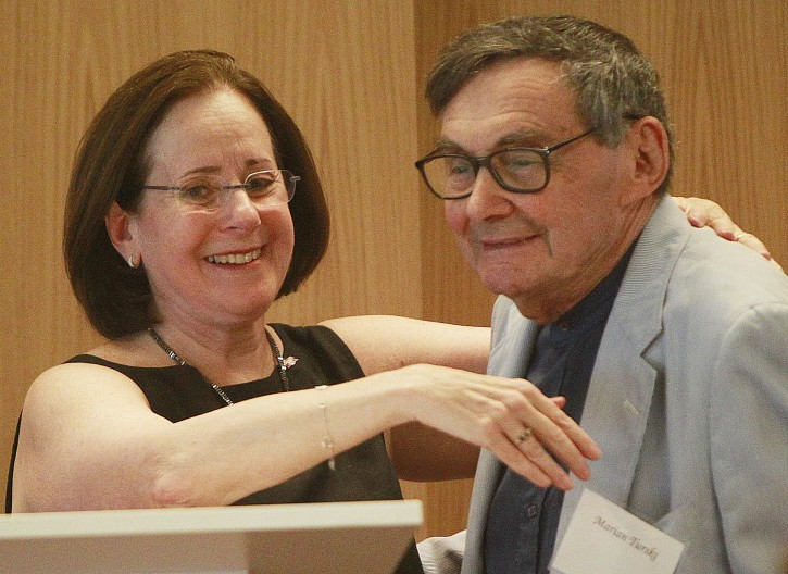 Stanlee Stahl, left, executive vice president of the Jewish Foundation for the Righteous, hugs Marian Turski, a Holocaust survivor, in Warsaw, Poland, on July 10, 2016. A group of Polish Christians who risked their lives to give aid to Jews during the Holocaust were brought together for a luncheon in Warsaw to be honored and celebrated by a U.S.-based Jewish organization that provides aid to these rescuers. (AP Photo/Czarek Sokolowski)