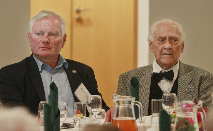 Ryszard Zielinski, 85, right, a Pole who helped to save Jews during World War II, attends a luncheon, accompanied by his son Mieszko, in Warsaw, Poland, on July 10, 2016. A group of Polish Christians who risked their lives to give aid to Jews during the Holocaust were brought together for a luncheon in Warsaw to be honored and celebrated by a U.S.-based Jewish organization that provides aid to these rescuers. (AP Photo/Czarek Sokolowski)