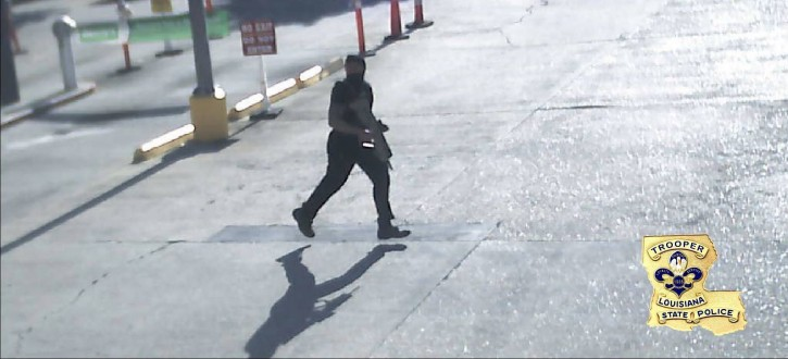 This Sunday, July 17, 2016, security video frame grab made available by the Louisiana State Police shows Gavin Eugene Long dressed in black and carrying a gun in Baton Rouge, La. Authorities said Long ambushed law enforcement officers fatally shooting multiple officers and injuring several others before he was killed. (Louisiana State Police via AP)