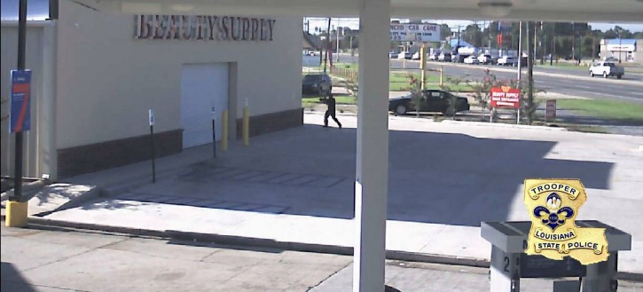 In this Sunday, July 17, 2016, security video frame grab made available by the Louisiana State Police, Gavin Eugene Long dressed in black appears to take aim while in a shopping center in Baton Rouge, La. Authorities said Long ambushed law enforcement officers fatally shooting multiple officers and injuring several others before he was killed. (Louisiana State Police via AP)
