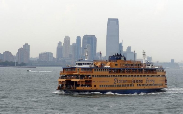 FILE - Commuters ride the Staten Island ferry in New York August 3, 2012. REUTERS/Charles Platiau