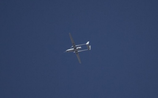 FILE - An Israeli drone flies over the West Bank city of Hebron June 14, 2014.REUTERS