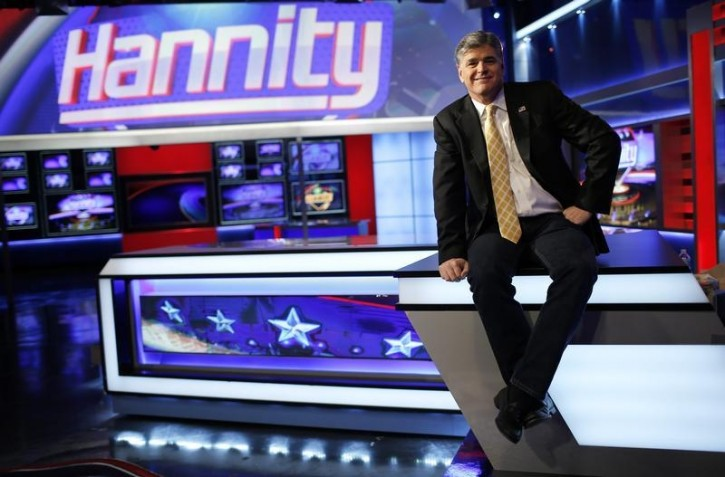 "FILE - Fox News Channel anchor Sean Hannity poses for photographs as he sits on the set of his show ""Hannity"" at the Fox News Channel's studios in New York City, October 28, 2014.  REUTERS/Mike Segar"