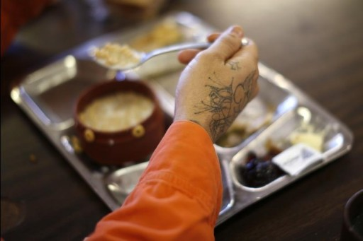 FILE - A prison inmate eats breakfast at Oak Glen Conservation Fire Camp #35 in Yucaipa, California November 6, 2014. REUTERS
