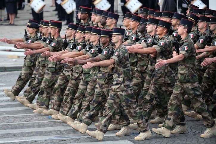 Soldiers of the 92e RI from Operation Sangaris march during the traditional Bastille Day military parade on the Place de la Concorde in Paris, France, July 14, 2016. REUTERS/Charles Platiau