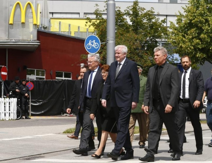 Bavarian Interior Minister Joachim Herrmann, Bavarian Prime Minister Horst Seehoffer and Munich Mayor Dieter Reiter (L-R) visit a scene near the Olympia shopping mall, where yesterday's shooting rampage started, in Munich, Germany July 23, 2016.  REUTERS/Arnd Wiegmann