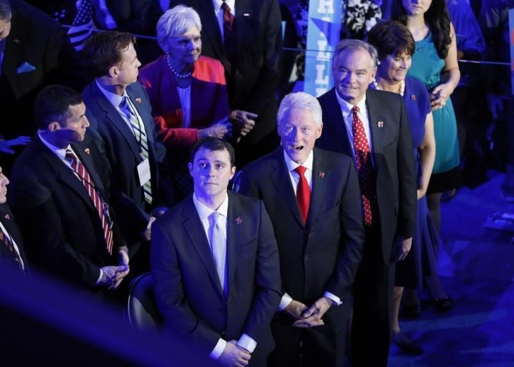 Former U.S. President Bill Clinton watches a video about Democratic presidential nominee Hillary Clinton with her vice presidential running mate Senator Tim Kaine at the Democratic National Convention in Philadelphia, Pennsylvania, U.S. July 28, 2016. REUTERS/Rick Wilking.