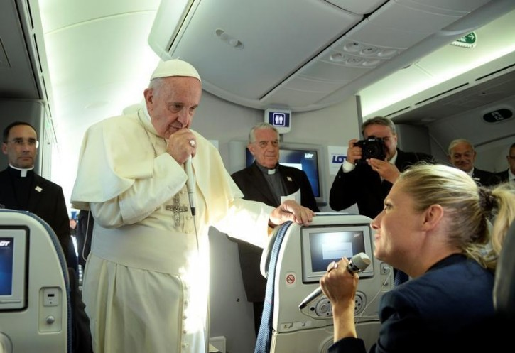 Pope Francis speaks to journalists during a press conference on the plane after his visit to Krakow, Poland, for the World Youth Days, July 31, 2016. REUTERS/Filippo Monteforte/Pool
