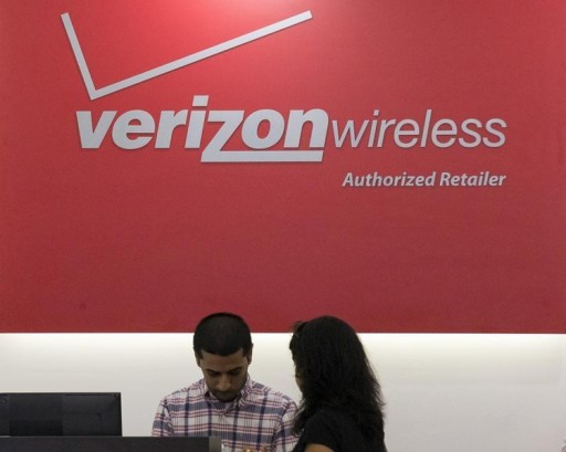 FILE -A woman is cashed out at a Verizon store in New York's financial district May 12, 2015. Reuters