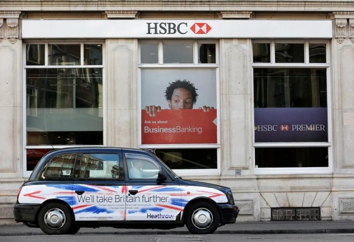 FILE - A taxi drives past a branch of HSBC bank in London February 9, 2015.   REUTERS/Suzanne Plunkett/File Photo