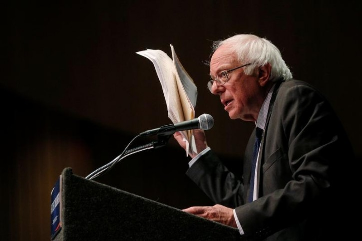 FIEL - U.S. Democratic presidential candidate and U.S. Senator Bernie Sanders holds up his notes while speaking about his attempts to influence the Democratic party's platform during a speech in Albany, New York, U.S., June 24, 2016.  REUTERS/Brian Snyder