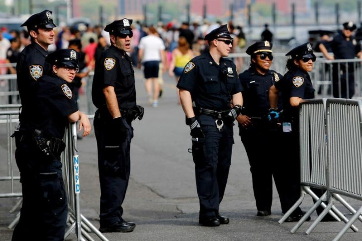 NYPD officers stand guard at the east side before Macy's 4th of July Fireworks Independence Day celebrations in New York July 4, 2016.  REUTERS/Eduardo Munoz