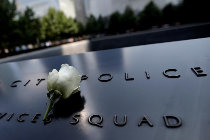 A single white rose is left at the edge of the South Pool of the 911 Memorial atop the area of the memorial for New York City Police (NYPD) officers killed in the 2001 attacks on the World Trade Center, following the deadly shootings of police officers in Dallas, Texas, in Manhattan, New York, U.S., July 8, 2016. REUTERS/Mike Segar