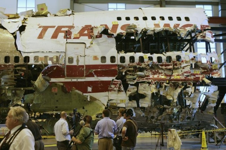 FILE- The remains of the TWA Flight 800 from New York to Paris that exploded off Long Island, New York, reassembled from recovered wreckage, is on display at National Transportation Safety Board (NTSB) Training Facility in Ashburn, Virginia, July 16, 2008.  Reuters