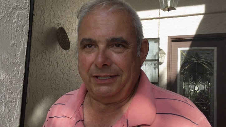 """In this image from video, Frank Baressi speaks during an interview with The Associated Press at his home in Palm Harbor, Fla. Thursday, June 30, 2016. Baressi, 62, was the driver of the truck that was hit by a Tesla that Joshua D. Brown, of Canton, Ohio, was operating in self-driving mode, and who was killed in the May 7 accident in Williston, Fla. Baressi said the driver was """"playing Harry Potter on the TV screen"""" at the time of the crash and driving so quickly that """"he went so fast through my trailer I didn't see him."""" (AP Photo/Tamara Lush)"""