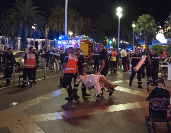 Wounded people are evacuated from the scene where a truck crashed into the crowd during the Bastille Day celebrations in Nice, France, 14 July 2016. EPA