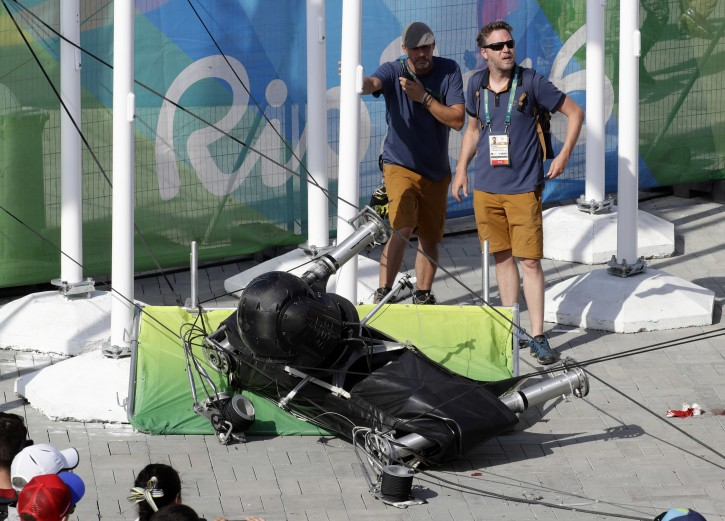 An overhead camera that fell from wires suspending it over Olympic Park lays on the ground at the Summer Games in Rio de Janeiro, Brazil, Monday, Aug. 15, 2016. (AP Photo/Robert F. Bukaty)