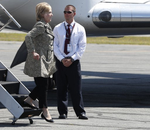 Democratic presidential candidate Hillary Clinton steps from her campaign plane as she arrives at Nantucket Memorial Airport in Nantucket, Mass., Saturday, Aug. 20, 2016., en route to a fundraiser. (AP Photo/Carolyn Kaster)