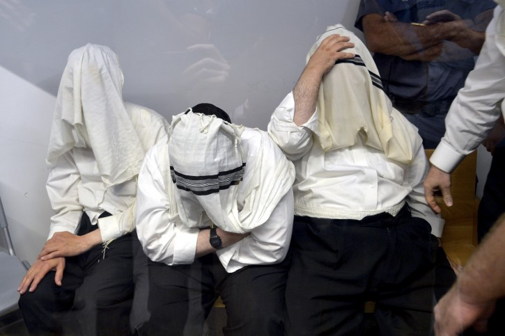Six teachers of an ultra-Orthodox school in Tel Aviv are brought to a court hearing at the Tel Aviv district court on August 2, 2016, The six teachers accused of physical abuse of pupils, and one of them in sexual abuse. Photo Roy Alima/Flash90