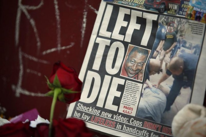 FILE - A picture of Eric Garner is seen on a newspaper at his memorial in Staten Island, New York, July 21, 2014. Reuters