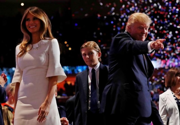 FILE - Balloons and confetti fall as Republican U.S. presidential nominee Donald Trump points into the crowd with his wife Melania (L) and his son Barron (C) at his side at the end of the final session of the Republican National Convention in Cleveland, Ohio, U.S. July 21, 2016. REUTERS/Mark Kauzlarich