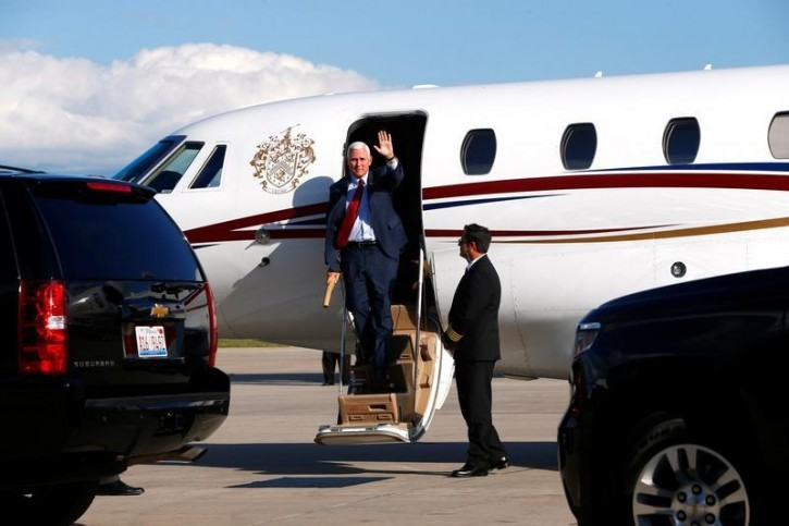 Republican U.S. vice presidential candidate Mike Pence arrives at the airport in Green Bay, Wisconsin August 5, 2016. REUTERS/Eric Thayer -