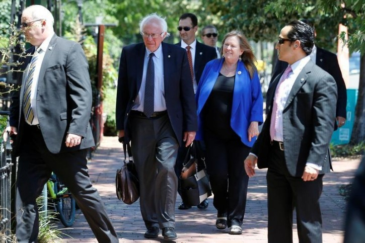 FILE - Democratic U.S. presidential candidate Bernie Sanders walks with his wife Jane Sanders to his campaign headquarters on Capitol Hill in Washington, U.S. June 20, 2016.  REUTERS/Jonathan Ernst