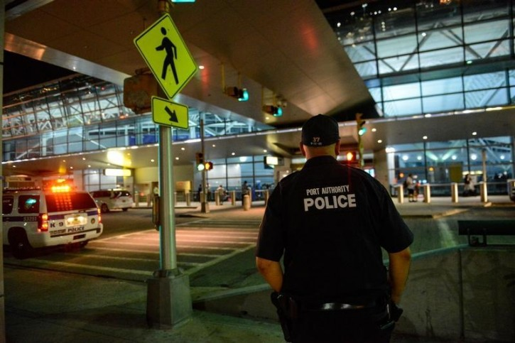 Members of the Port Authority Police Department stand guard at Terminal 8 at John F. Kennedy airport in the Queens borough of New York City, August 14, 2016. REUTERS/Stephanie Keith