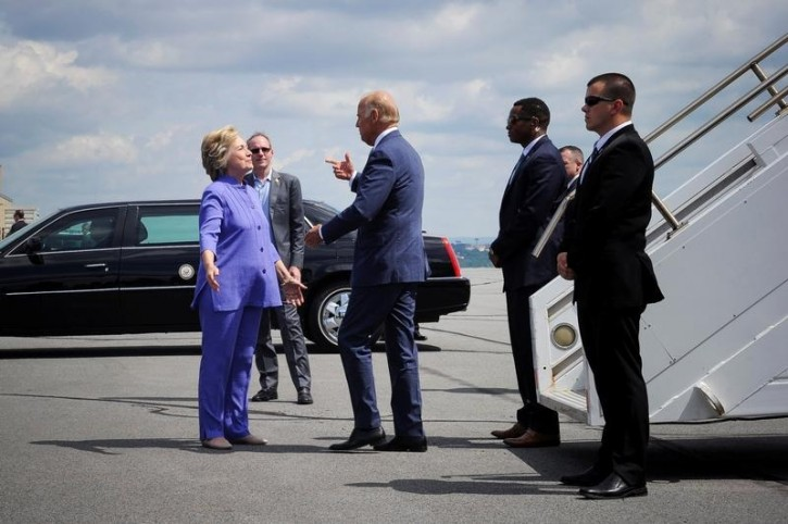 Democratic presidential nominee Hillary Clinton welcomes Vice President Joe Biden as he disembarks from Air Force Two for a joint campaign event in Scranton, Pennsylvania, August 15, 2016. REUTERS/Charles Mostoller