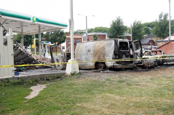 A burned down gas station is seen after disturbances following the police shooting of a man in Milwaukee, Wisconsin, U.S. August 15, 2016. REUTERS/Aaron P. Bernstein