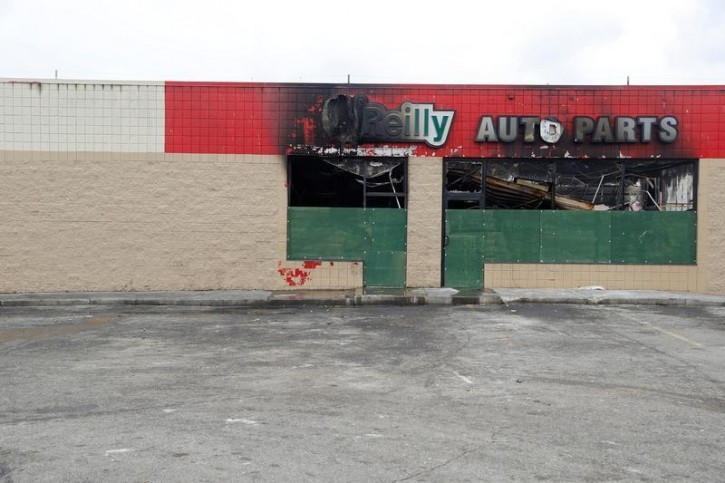 A burned down auto parts store is seen after disturbances following the police shooting of a man in Milwaukee, Wisconsin, U.S. August 15, 2016. REUTERS/Aaron P. Bernstein
