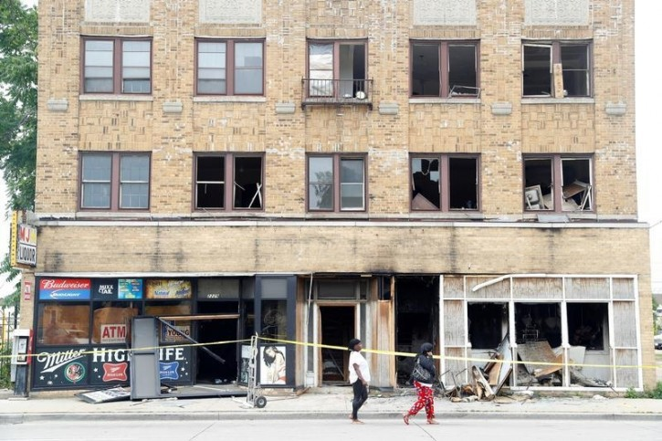 A burned down liquor store is seen after disturbances following the police shooting of a man in Milwaukee, Wisconsin, U.S. August 15, 2016. REUTERS/Aaron P. Bernstein