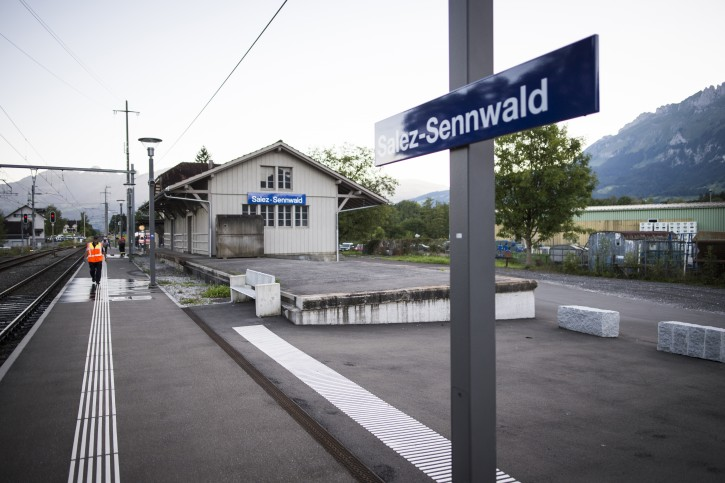 The train station is deserted at Salez - Sennwald following an attack aboard a train when a man attacked other passengers aboard the train at Salez, Switzerland, on Saturday, Aug. 13, 2016.  Police in Switzerland say a Swiss man set a fire and stabbed people on a train in the country's northeast, wounding six people some seriously, and injuring himself. (Gian Ehrenzeller / Keystone via AP)