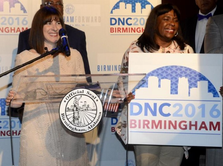 FILE - Amy Dacey(L), CEO of the Democratic National Committee, speaks at Iron City Birmingham in Birmingham, Ala., Monday, July 21, 2014. (AP Photo/AL.com, Mark Almond)