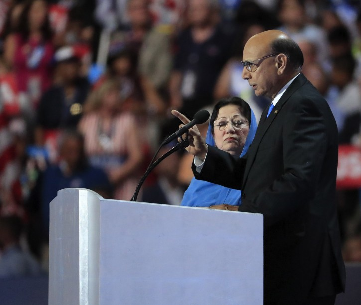 A picture made available on 01 August 2016 shows Khizr Khan (R), father of fallen soldier Human S. M. Khan and his wife Ghazala Kahn (L), holding a copy of the United States Constitution on stage during final day of the Democratic National Convention at the Wells Fargo Center in Philadelphia, Pennsylvania, USA, 28 July 2016. The Khan family where involved in a discussion with Republican Presidential nominee Donald Trump after he made remarks about their speech at the DNC convention.  EPA/TANNEN MAURY
