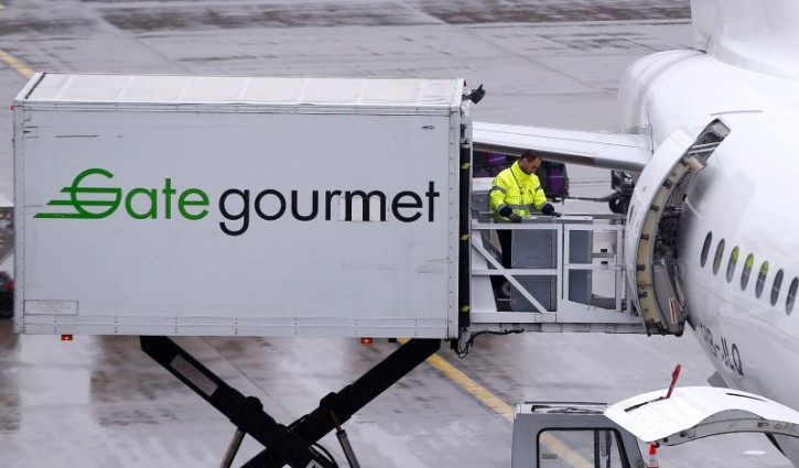 FILE - Gate Gourmet staff, part of Swiss airline catering firm Gategroup Holdings, loads a trolley aboard an Airbus A320-214 airplane of Swiss airline at Zurich airport, Switzerland, April 14, 2016.   REUTERS/Arnd Wiegmann/File Photo
