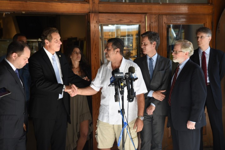 Daniel Peretz, owner of King David Gallery thanks Governor Andrew M. Cuomo, Senate Majority Leader John Flanagan and Assembly Speaker Carl Heastie as they announced an agreement to help small businesses, homeowners and renters access state funds for uninsured losses and physical damage they have incurred as a result of the Chelsea explosion. ( Gov. Cuomo Office)