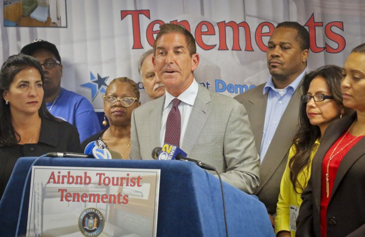 N.Y. State Senators Jeff Klein, center, and Diane Savino, far left, are joined by local residents during a press conference to announce a legislative housing code proposal for Airbnb, Monday Sept. 26, 2016, in New York.  (AP Photo/Bebeto Matthews)