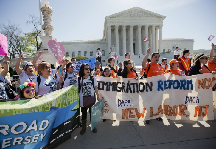 Supporters of fair immigration reform gather in front of the Supreme Court in Washington, Monday, April 18, 2016. The Supreme Court is taking up an important dispute over immigration that could affect millions of people who are living in the country illegally. The Obama administration is asking the justices in arguments today to allow it to put in place two programs that could shield roughly 4 million people from deportation and make them eligible to work in the United States. (AP Photo/Pablo Martinez Monsivais)